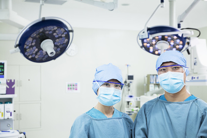 Portrait of two surgeons wearing surgical masks in the operating