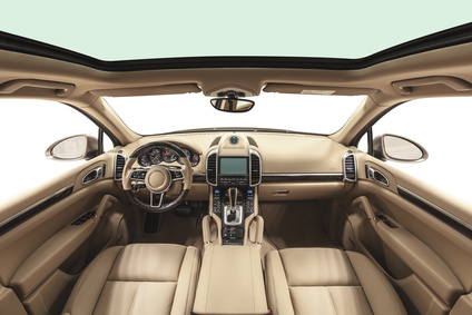 Interior of prestige modern car. Beige cockpit
