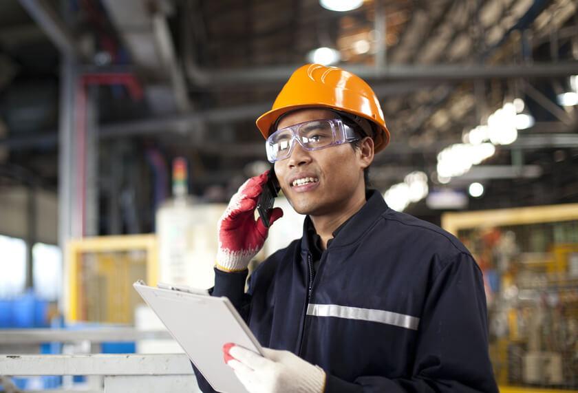 Industrial engineer talking phone